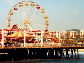 Ferris wheel at an amusement park on top of the Santa Monica Pier in Los Angeles, California