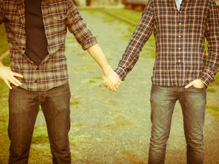 Gay Couple Outdise Holding Hands