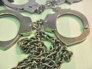 Pair of metal handcuffs