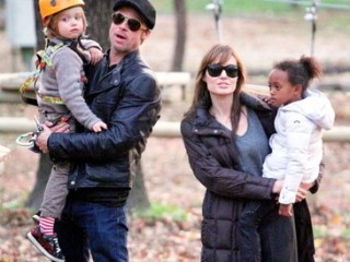 Brad Pitt and Angelina Jolie take their children Pax, Zahara and Shiloh to a park in Budapest, Hungary, on Friday.  Jolie is in Hungary filming her directorial debut. November 5, 2010.    *** Local Caption ***